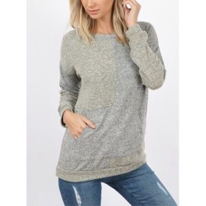 Thick knit color block top with front pouch pocket